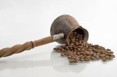 Turkish coffee pot. Turkish coffee pot and coffee grains on a white background Stock Photos