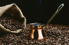 A Turkish coffee pot with beans. And a sack Stock Photo