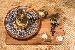 Turkish coffee pot boiling. Coffee brewing and drinking ceremony. Royalty Free Stock Photos