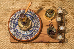 Turkish coffee pot boiling. Coffee brewing and drinking ceremony. Royalty Free Stock Images