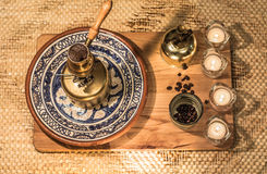 Turkish coffee pot boiling. Coffee brewing and drinking ceremony. Stock Photography