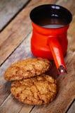 Turkish coffee pot cezve and oat cookies Stock Photos