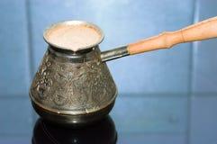 Turkish coffee pot with coffee royalty free stock photos