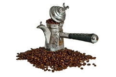 Turkish coffee pot and coffee beans Royalty Free Stock Image