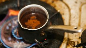 Coffee pot on fire. Turkish Coffee pot on fire Stock Photos