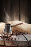 Turkish coffee pot on old plank Stock Images