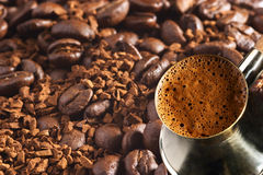 Turkish coffee-pot over coffee background Royalty Free Stock Photo