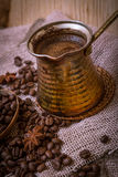 Turkish coffee-pot over coffee beans Stock Photography