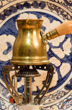 Turkish coffee pot on portable stove. Royalty Free Stock Images