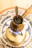 Turkish coffee pot on portable stove. Stock Photography