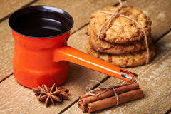 Turkish coffee pot, spices and cookies Stock Image