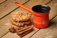 Turkish coffee pot, spices and cookies Royalty Free Stock Photos