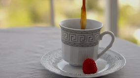Turkish coffee pouring. Pouring Turkish coffee artificial slow motion stock video