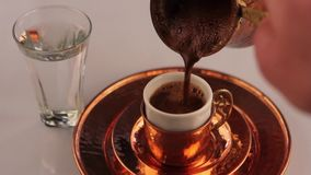Turkish Coffee Pouring with coffee pot. Turkish Coffee Pouring with foam stock footage