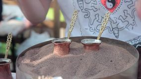 Turkish coffee prepared on hot sand stock footage