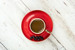Turkish Coffee in red cup. On wooden texture Royalty Free Stock Image