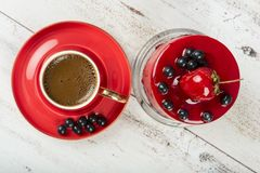 Turkish Coffee in red cup. On wooden texture Stock Photography