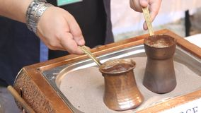 Turkish coffee in sand Stock Photography