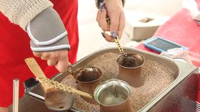 Turkish coffee in sand stock video
