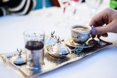 Turkish coffee served in Anatolian silverware Royalty Free Stock Photos