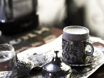 Turkish coffee served with custom made metal coffee cups and porcelain cups.  royalty free stock image