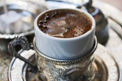 Turkish Coffee. Served in a porcelain cup Royalty Free Stock Photo