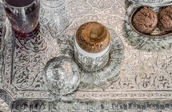 Turkish coffee served with sherbet and cookies in traditional copper serving set Stock Photography