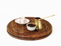 Turkish coffee is served with a traditional Turkish delight. Turkish coffee served in a traditional manner. There is an ibrik, a fildzan and of course a few royalty free stock image