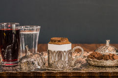 Turkish coffee served with water, sherbet  and cookies in traditional copper serving set Stock Image