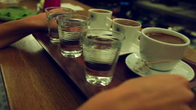 Turkish Coffee Serving. Waitress serving turkish coffee and turkish delight to customers stock video footage