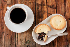 A Turkish coffee set with Cezve mince pies and white cup, served on wooden table Stock Photo