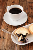 A Turkish coffee set with Cezve mince pies and white cup, served on wooden table Stock Image