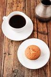 A Turkish coffee set with Cezve muffin and white cup, served on wooden table Royalty Free Stock Images