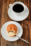 A Turkish coffee set with Cezve muffin and white cup, served on wooden table Stock Photography