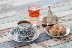 Turkish coffee in traditional cup with glass of water and turkis Stock Images