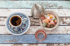 Turkish coffee in traditional cup with glass of water and turkis Royalty Free Stock Images