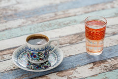 Turkish coffee in traditional cup with glass of water Royalty Free Stock Photos