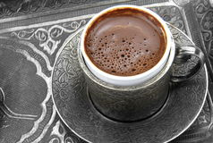 Turkish coffee with traditional embossed metal cup and tray Stock Photos