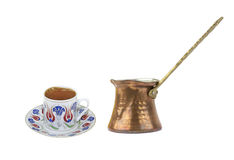 Turkish coffee with traditional ottomans motif cup and copper coffe pot. Isolated on white background stock images