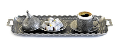 Turkish coffee and turkish delight with old traditional embossed  metal cup and tray Stock Photo