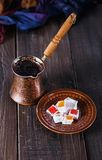 Turkish coffee and Turkish Delight over dark wooden background Royalty Free Stock Image