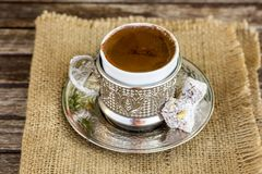Turkish coffee and turkish delight. Turkish coffee with delight and traditional copper serving set stock photo