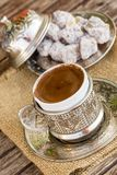 Turkish coffee and turkish delight. Turkish coffee with delight and traditional copper serving set stock image