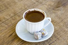 Turkish coffee and turkish delight. Turkish coffee with delight and traditional copper serving set stock photos