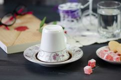 Turkish Coffee and Turkish Delight. Turkish Coffee in White Porcelain Cup and Turkish Delight.Single overturned coffee cup on the plate for coffee divination royalty free stock photos