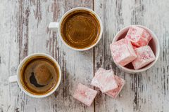 Turkish Coffee with Turkish Delight. On white wooden background stock photo