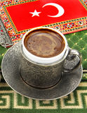 Turkish coffee and turkish flag on a carpet Royalty Free Stock Photography