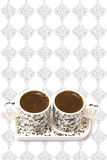 Turkish coffee in two cups on a white background Royalty Free Stock Photos