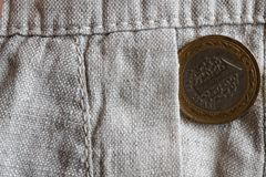 Turkish coin with a denomination of 1 lira in the pocket of old linen pants. Turkish coin with a denomination of one lira in the pocket of old linen pants Stock Images
