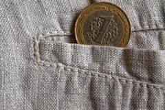 Turkish coin with a denomination of one lira in the pocket of worn linen pants Royalty Free Stock Image